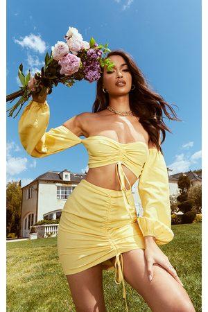 PRETTYLITTLETHING Lemon Ruched Mini Skirt