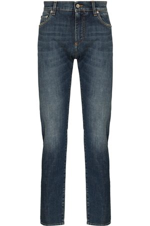 Dolce & Gabbana Distressed mid-rise slim-fit jeans