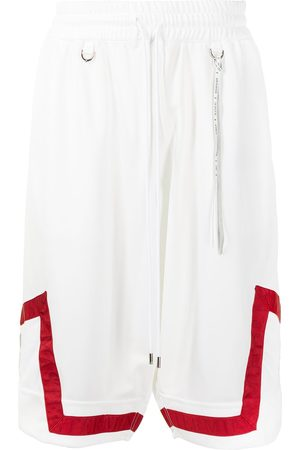 MASTERMIND Men Sports Shorts - Stripe-print knee-length shorts