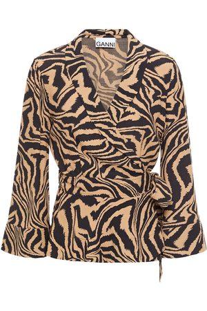 Ganni Women Wrap tops - Woman Floral-print Crepe Wrap Top Animal Print Size 32