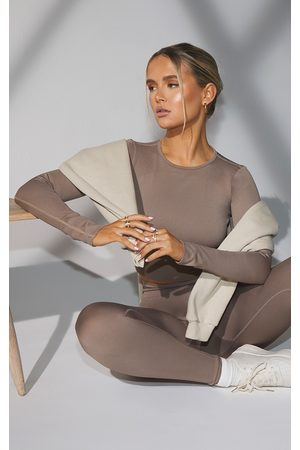 PRETTYLITTLETHING Taupe Seamless Long Sleeve Rib Detail Sports Top