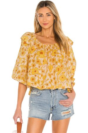 Free People Miss Daisy Printed Top in Yellow.