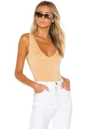 Lovers + Friends Diane Bodysuit in Beige.