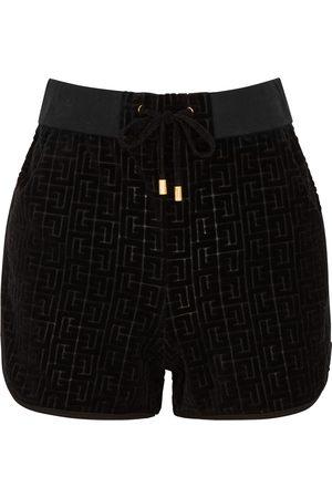Balmain Monogrammed velvet shorts