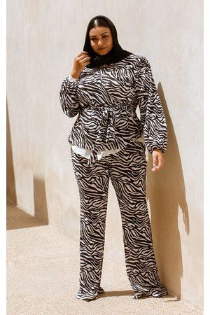 PRETTYLITTLETHING Plus Zebra Print Shoulder Pad Wrap Plisse Blouse