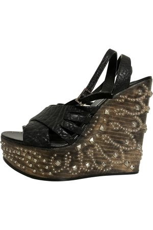 Roberto Cavalli \N Leather Mules & Clogs for Women