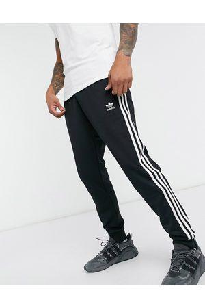 adidas Adicolor three stripe skinny sweatpants in