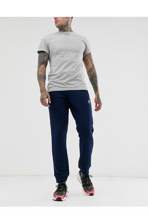 adidas Essentials logo sweatpants in navy