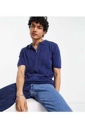 Reclaimed Vintage Inspired the Short Sleeve Knitted 1/4 Zip Polo in Navy