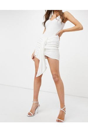 Femme Luxe Sequin mini skirt with knot detail in