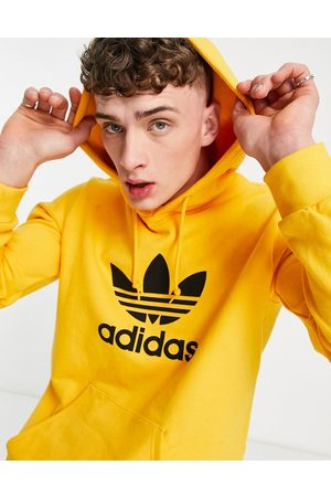 adidas Large trefoil hoodie in active
