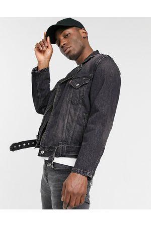 Levi's Moto relaxed fit denim trucker jacket in rider dark wash-Grey