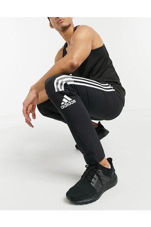 adidas Adidas ZNE 3 stripe sweatpants in