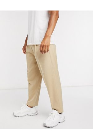 ASOS Oversized tapered smart trouser in stone-Neutral