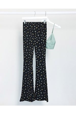Topshop Ditsy print flared pants in multi