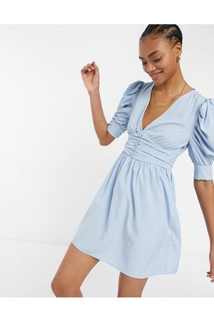 VILA Mini dress with wrap front and ruffled 3/4 length sleeves in blue-Blues