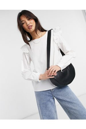 VILA Long sleeve t-shirt with frill shoulder detail in