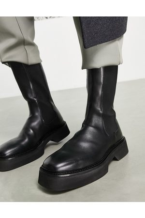 ASOS High chelsea calf boots in leather on a chunky sole