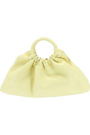 Nanushka Trapeze Bag in Yellow.