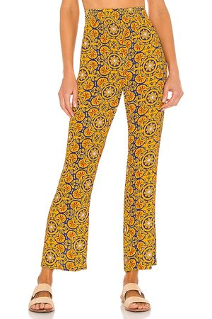 WeWoreWhat Smocked Flare Pant in Mustard.