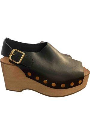 Céline \N Leather Mules & Clogs for Women