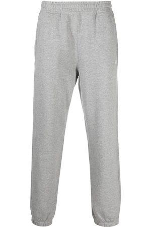 STUSSY Overdyed stock logo track pants - Grey