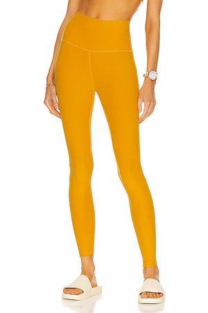 Beyond Yoga Spacedye Caught in the Midi High Waisted Legging in Orange