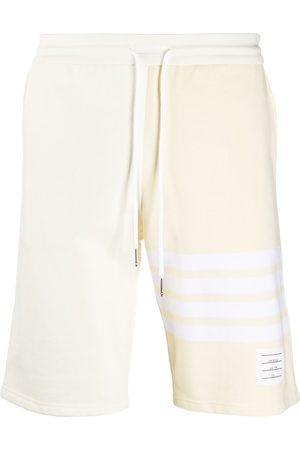 Thom Browne Men Sports Shorts - 4-Bar stripe tonal track shorts - Neutrals