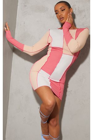 PRETTYLITTLETHING Patchwork Overlock Stitch Detail Long Sleeve Bodycon Dress