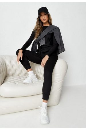 Missguided Women Playsuits - Rib Long Sleeve Tie Waist Jogger Romper