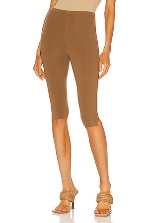 Totême Cropped Compact Knit Leggings in Brown