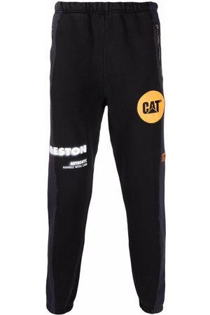 Heron Preston Men Sweatpants - X Caterpillar logo-embroidered track pants - 1018
