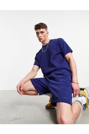 adidas Men Shorts - X Pharrell Williams premium shorts in navy