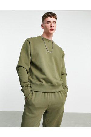 adidas X Pharrell Williams premium sweatshirt in khaki