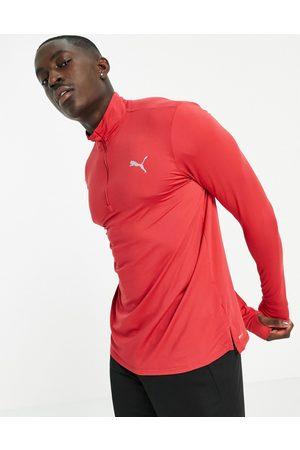 PUMA Running Favorite quarter zip sweatshirt in