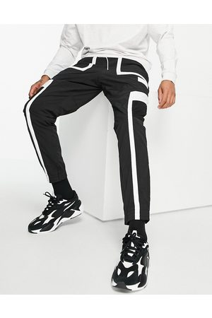 PUMA Hoops track pants in and white