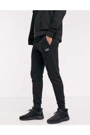 EA7 Armani Core ID rubberized logo sweatpants in