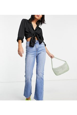 ASOS ASOS DESIGN Petite high rise 'Y2K' stretch flare jeans in midwash-Blues