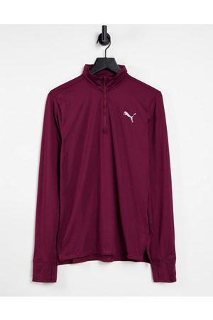 PUMA Running Favorite quarter zip sweatshirt in burgundy