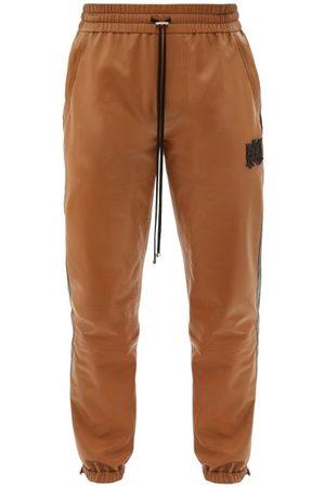 AMIRI M.a. Logo-appliqué Plongé-leather Track Pants - Mens