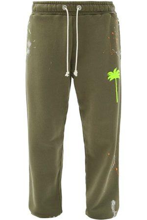 Palm Angels Paint-splatter Cotton-jersey Track Pants - Mens - Khaki Multi