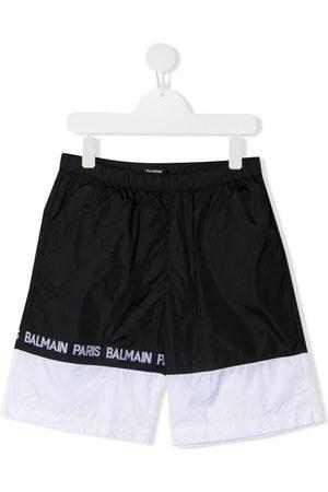 Balmain Kids Logo tape colour block swim shorts