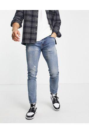 Levi's 512 slim taper fit jeans in lefkas village distressed flex stretch light indigo wash-Blues