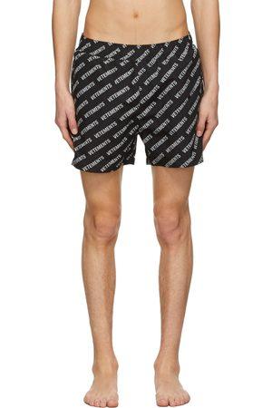 Vetements All-Over Logo Swim Shorts