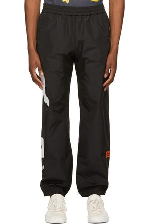 Heron Preston Men Sweatpants - Logo Spray Track Lounge Pants