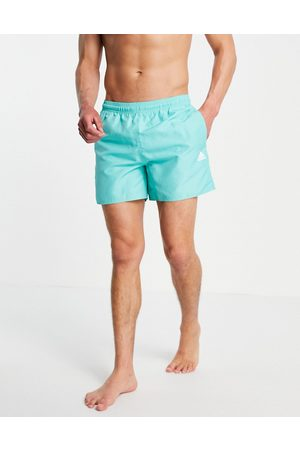 adidas Adidas Training badge of sport logo swim shorts in mint