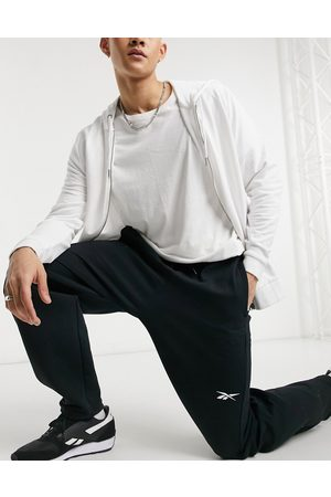 Reebok Techstyle DreamBlend drawstring tapered sweatpants in