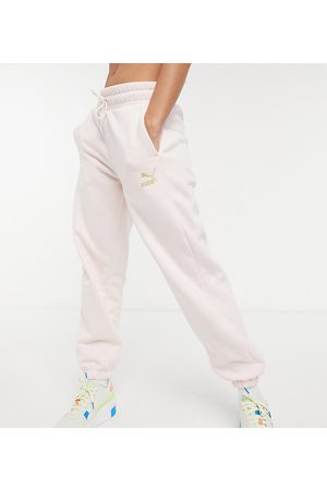 PUMA Oversized sweatpants in and gold