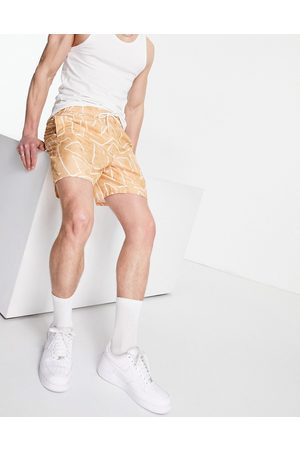 ASOS Swim shorts with abstract geo print in stone-Neutral
