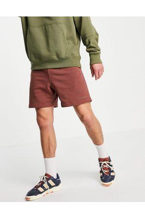 adidas X Pharrell Williams premium shorts in burgundy